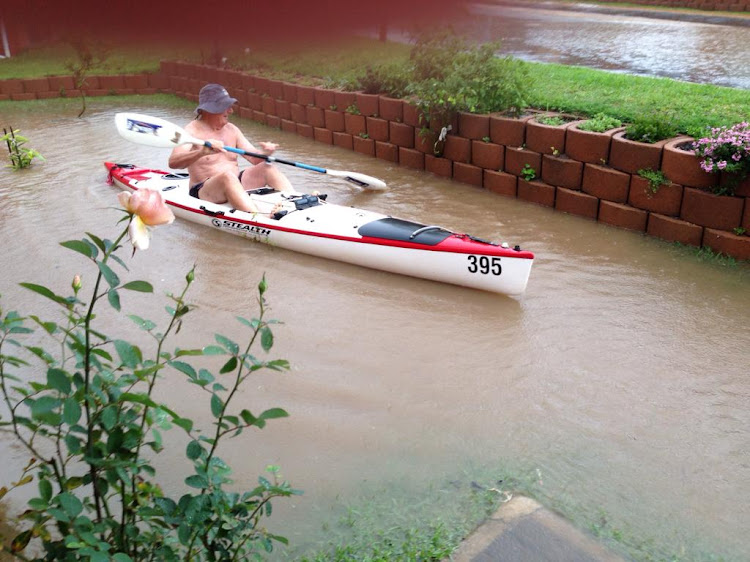A resident of a KZN retirement village took out his paddle-ski when heavy rain fell on Sunday afternoon.