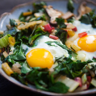 Eggs Nested in Sautéed Chard and Mushrooms.