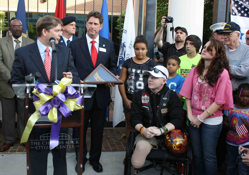 Photo: N.C. Rep. Grey Mills presented Garrett Carnes an American flag.