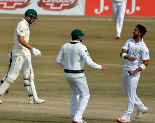 Hasan Ali (R) celebrates after taking the wicket of Aiden Markram.