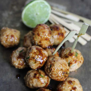 Baked Chicken Bites rolled in Sweet Ginger, Sesame-Simply Stirred.