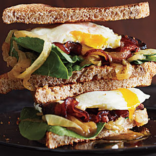 Bacon and Egg Sandwiches with Caramelized Onions and Arugula.