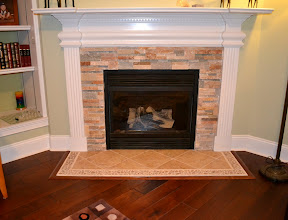 Photo: REAL Natural Stone with Porcelain Diamonds and Travertine Stone Border Pictured Framed with Wood Accent