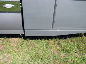 Photo: The bottom trim detail This is sloped up for looks, but really it is sloped so that you can slide under the truck. There is enough space so that you can slide right under the back part on a creeper. Barely.
