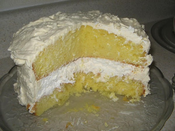 Spread a thick layer on this mixture on the bottom layer on your cake...
