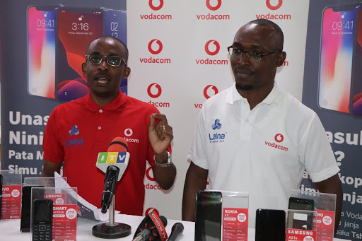 Vodacom Tanzania's Head of Sales and Distributions, Consumer Business Unit, George Lugata (L), along with Laina Finance Ltd Managing Director Mrisho Shomari during the launch of new loan services for smartphones.