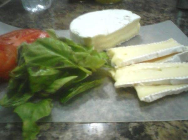 Slice tomato and arrange over Brie.
