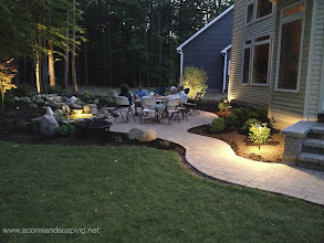 """Photo: Landscape Lighting, Monroe County, Rochester NY, LED Outdoor lighting Designer, Installer Rochester NY. Stunning Outdoor Room with Low Voltage LED Landscape Lighting or #OutdoorLighting in Monroe County, Greece NY by Acorn Ponds & Waterfalls of Rochester NY, Certified Aquascape Contractor since 2004.  Visit our website www.acornponds.com and please give us a call 585.442.6373.  The addition of a Landscape Lighting Design can make any Outdoor Living Area an Outdoor Retreat every night! Installing a Commercial or Contractor Grade Lighting System will ensure that you can enjoy your Nightscaping for years and save money on your electric bills. Included in this Outdoor Living Area: Led Low Voltage Landscape Lighting, #LandscapeDesign, Ecosystem Water Garden Fish Pond, Stream, #Waterfalls, Techo-Bloc Paver Patio, Steps, Walkway and low maintenance plantings.  For more info about Landscape lighting, please click here: www.acornponds.com/led-lighting.html  Click here to learn more about Walter & Anna""""s amazing project: www.facebook.com/notes/acorn-landscaping-landscape-designlightingbackyard-water-gardens/landscaping-design-greece-ny-paver-patio-backyard-fish-pond-steps-led-lighting-i/386736208030174  To learn more about Landscape Design please click here: www.acornponds.com/landscape-design.html  Click here for a free Magazine all about Ponds and Water Features: http://flip.it/gsrNN  Find us on Houzz here: www.houzz.com/pro/acornlandscapedesign/acorn-landscaping-and-ponds-llc  Contact Acorn Ponds & Waterfalls now! 585.442.6373 or please click here: www.acornponds.com/contact-us.html"""