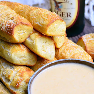 Homemade Parmesan Soft Pretzel Sticks with Beer Cheese Sauce.