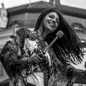 Drummer Girl by Iva Marinić - People Street & Candids ( woman, drum sticks, street, black and white, portrait, street photography, smile,  )