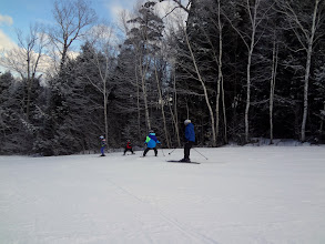Photo: The four kids skiing down the mountain - Julia, Jack, Grace, and Greg