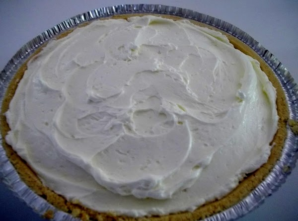Fold in whipped topping; spoon into crust.