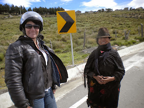 """Photo: We meet a lady walking up the hill toward us. Paula tries to explain, with our old paper catalog of pictures and weak Spanish that we're seeking alpacas, """"and this scarf is made of alpaca"""". Before we realized it this lady """"accepted"""" Paula's scarf. :)"""