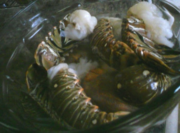 Put the lobster tails in the steamer basket, cover, and steam until they turn...