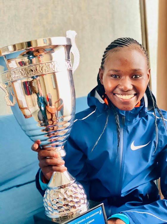 World marathon champion Ruth Chepng'etich with the trophy after winning the Istanbul Half Marathon in a world record time on Sunday