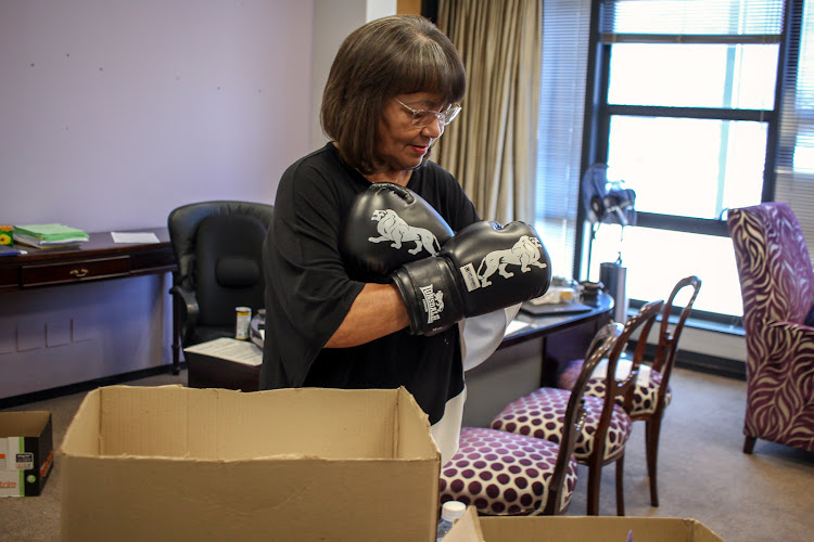 Former Cape Town mayor Patricia de Lille finds a pair of boxing gloves as she cleans up her office on October 31 2018.