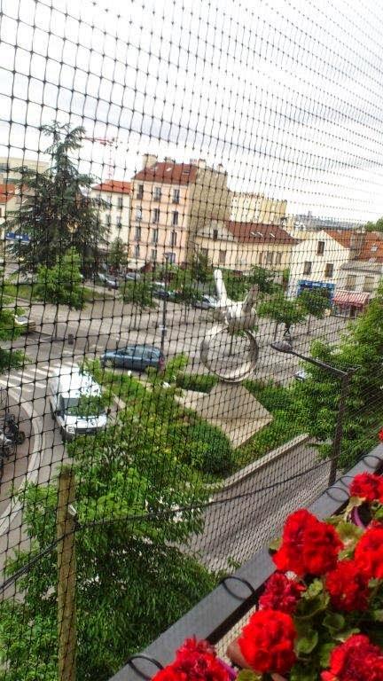 Photo: Filet de sécurité sur mesure pour chat à Boulogne Billancourt par Pagani & fils demande de devis jeanlouispagani.info@gmail.com téléphone : +32 476 95 25 11