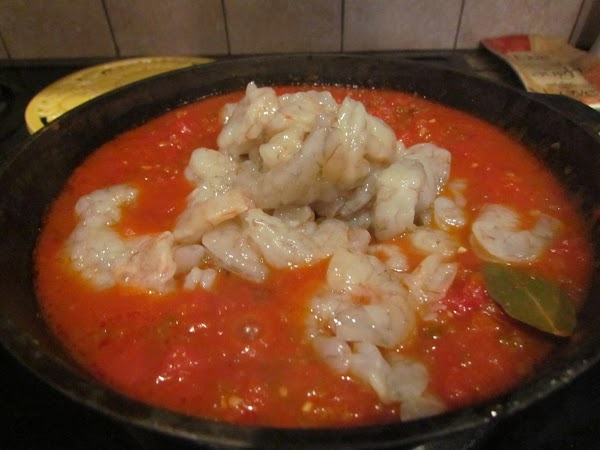 Add shrimp. Bring back to a boil, lower heat, and simmer for 5 more...