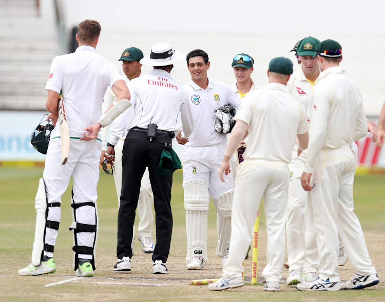 Quinton de Kock and Morne Morkel of the Proteas shake hands with the Australian players during the 2018 Sunfoil Test Series match between South Africa and Australia at Sahara Kings Park Stadium, Durban South Africa on the 05 March 2018.