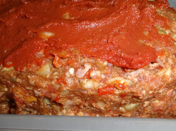 """""""Frost"""" the top of the meatloaf with the leftover tomato paste as depicted in..."""