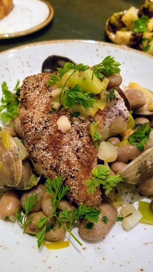 Quaintrelle, Pacific Northwest cuisine focused Portland restaurant that emphasizes 80-85% local ingredients. Meat and Fish section dish of Ling cod with borlotto beans, leeks, fennel, manila clams