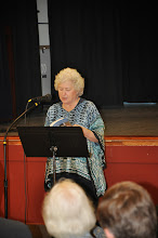 """Photo: Esther Altshul Helfgott concludes the reading of the anthology's second section, """"There."""""""
