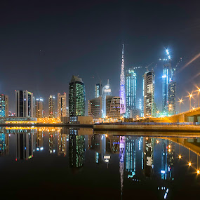 Dubai Business Bay by Ricky Pagador - City,  Street & Park  Skylines ( reflection, reflections, light, street, skyscraper, skyline, streetlight, streetlights )