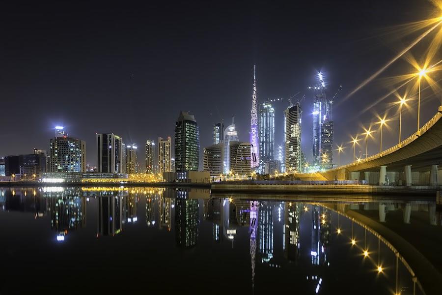 Dubai Business Bay by Ricky Pagador - City,  Street & Park  Skylines ( reflection, reflections, light, street, skyscraper, skyline, streetlight, streetlights )