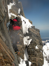 Photo: One foot follows the other. Crampons on the rock.
