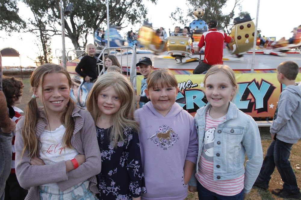RIGHT: Madison Kay, Zoe Harris, Hope Stafford and Ruby Clayton wait their turn for a ride at the West Public School Fete on Friday night.