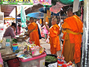 Photo: monks making their rounds in Hua Hin market for donations