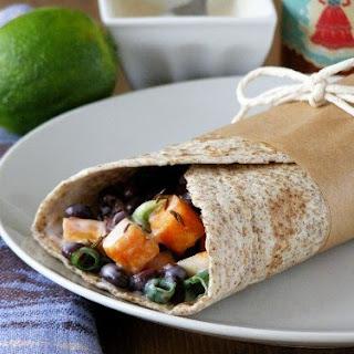 Cumin Roasted Sweet Potato and Black Bean Wrap with a Chilli Lime Yogurt Dressing