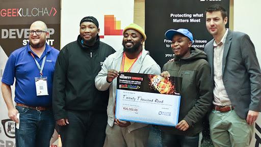 The winning Khululeka team receiving their R20 000 prize (from left): Seph Robbertse, Micro Focus; Gift Nyembe, PwC; Siyammukela Kasapo, James Miwahili, and Ivan Regasek, ITWeb.