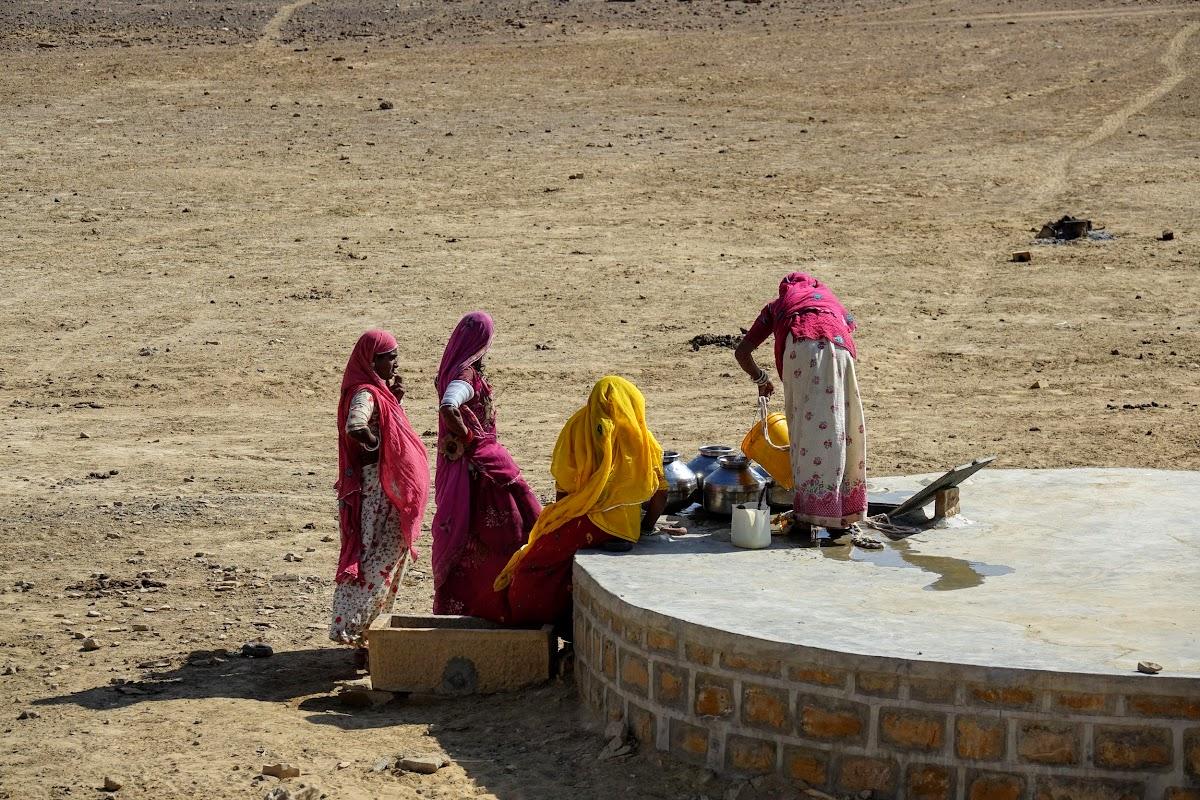 India. Rajasthan Thar Desert Camel Trek. Women pulling water