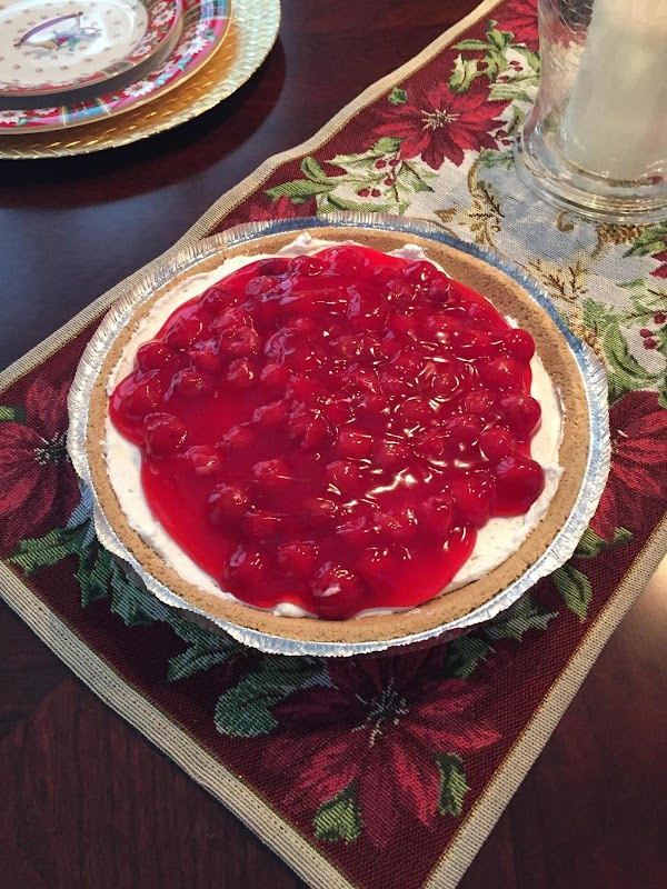 Pour cherry pie filling on to the top of the pie and cut into...