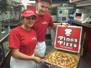 Photo: Shannon and Ross showing off a perfectly well done (standard practice!)pepperoni and sausage pizza pie.