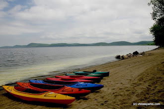 Photo: Rainbow of kayaks at Sand Bar State Park by Al Abrams