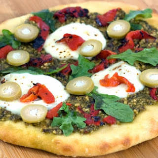 Pesto & Roasted Pepper Pizza with Blue Cheese Olives.