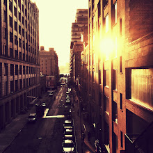 """Photo: """"Evening adagio...""""  In the evening when the sun slides along the buildings and shadows glide along the streets, the city lingers longingly in the last few moments of sunlit bliss as urban wanderers slow dance to the sun's daily adagio.    New York Photography: Chelsea sunset as seen from the High Line.   This photo was taken and edited with my phone. I am @newyorklens on Instagram (view my feed here: http://goo.gl/8hbcE ). You can check out some of my Instagram photos on Flickr here: http://goo.gl/BxNpG .    Additionally, you can view my phone photography for sale here:http://instaprints.com/profiles/newyorklens.html    View this post if you wish at my site here:  http://nythroughthelens.com/post/29642894823/sunset-view-from-the-high-line-chelsea-new-york  -  Tags: #photography  #nyc  #newyorkcity  #newyorkcityphotography  #city  #urban  #buildings  #architecture  #instagram  #mobilephotography  #iphonography  #iphoneographyfriday  #iphoneography  #writing  #prose  #sunset"""