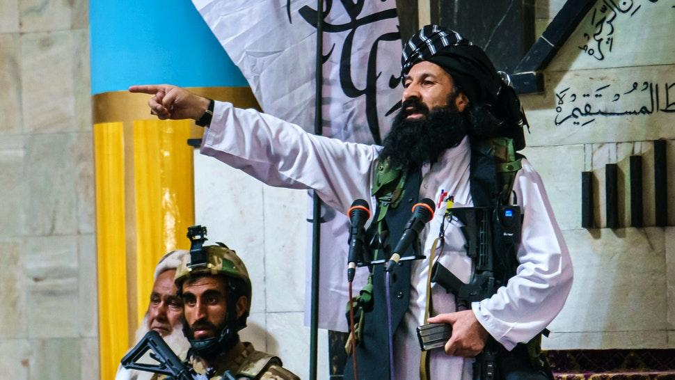 KABUL, AFGHANISTAN -- AUGUST 20, 2021: Khalil al-Rahman Haqqani, a leader of the Taliban affiliated Haqqani network, and a U.S.-designated terrorist with a five million dollar bounty, deliver his sermon to a large congregation at the Pul-I-Khishti Mosque in Kabul, Afghanistan, Friday, Aug. 20, 2021.