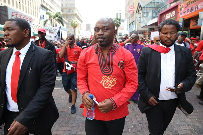 leader, Sbu Zikode, addresses a crowd of about 2,000 members outside the Durban city hall on October 8 2018