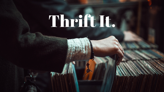 person going through records at a secondhand shop