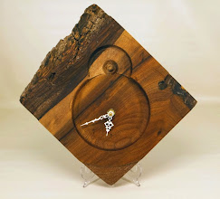 "Photo: Jeff Tate 9"" x 1 1/2"" clock [black cherry}"