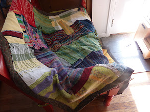 Photo: a collaboration blanket for a fellow ravelry group member who had her first baby. more than a dozen saori woven pieces were sent to me and i set about piecing and sewing  them into a gift  for her this is the out come.