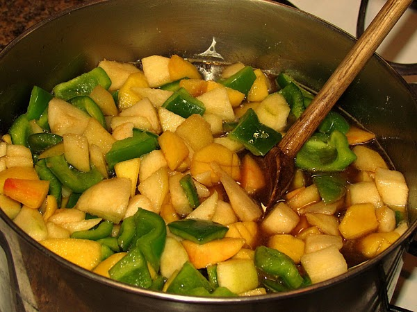 Place the peaches and pears in a 5 quart pot along with the peppers,...