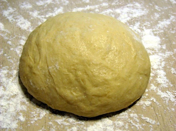 Punch down dough, knead in 2 tablespoons of flour. Cover and let rest for...