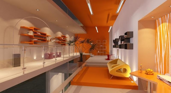 A modern designed room with orange walls and shelves and good lighting