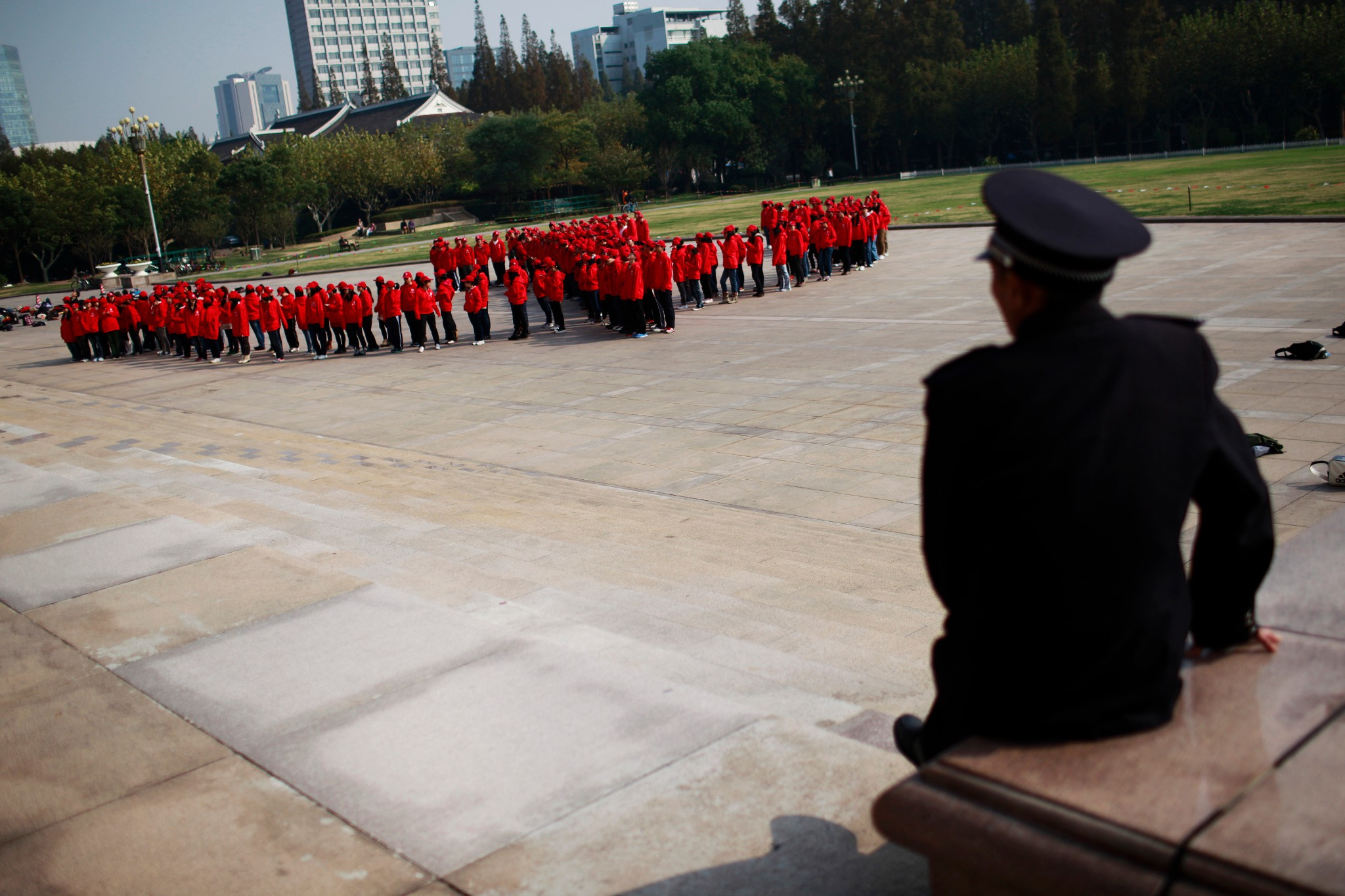 Photo: A security guard watches Fundan University students prepare for the party conference.