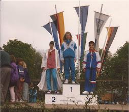 Photo: Heidi Green (Woollard) collects her bronze for 100m breaststroke