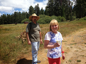Photo: Marty Cohen & Dalia Belinkoff walking through the Wildlands Conservancy meadow